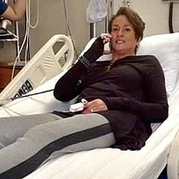 reporter Lisa Thomas-Laury in her hospital be on the phone