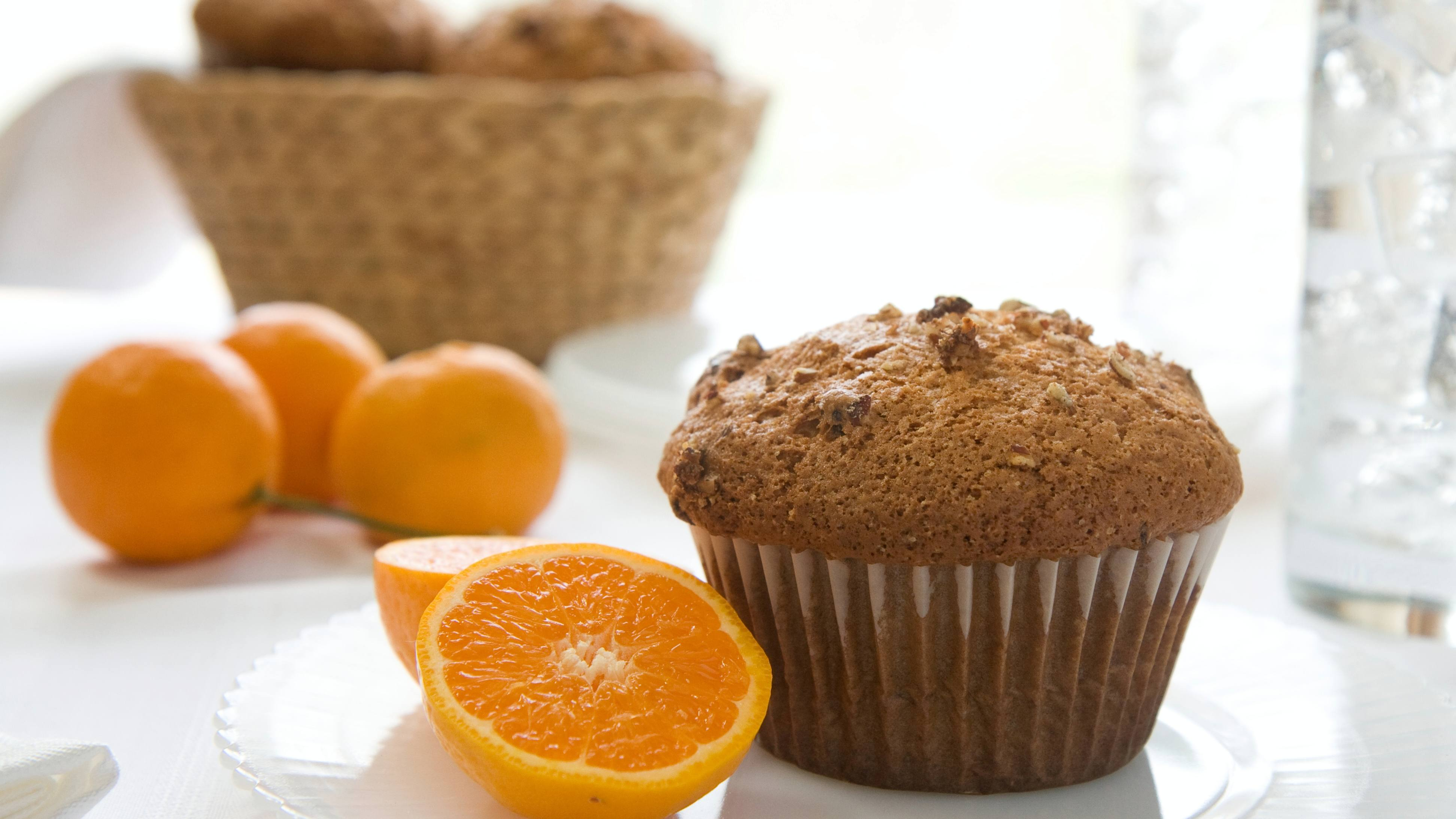 cranberry orange muffins on a plate