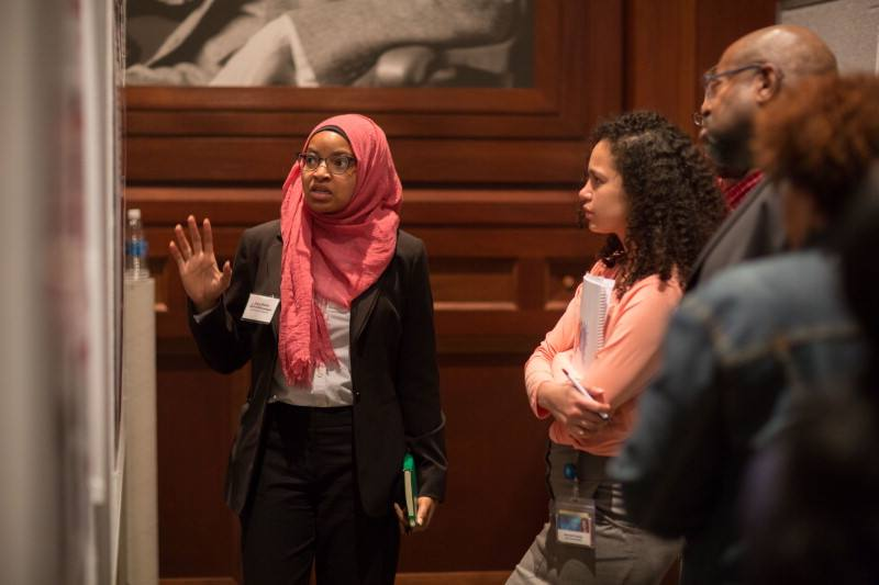 Diverse group of medical students looking at exhibit