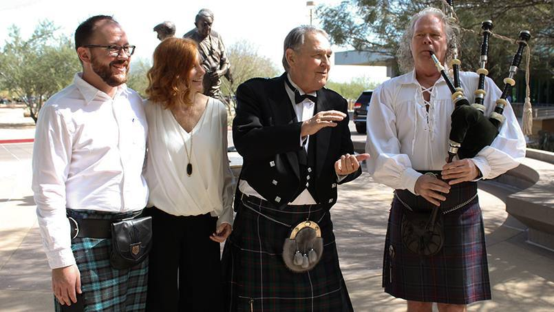 prostate cancer patient Doug Walsh in a kilt with family and a bagpiper