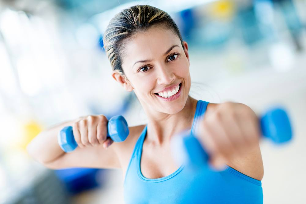 Strong woman weightlifting at the gym