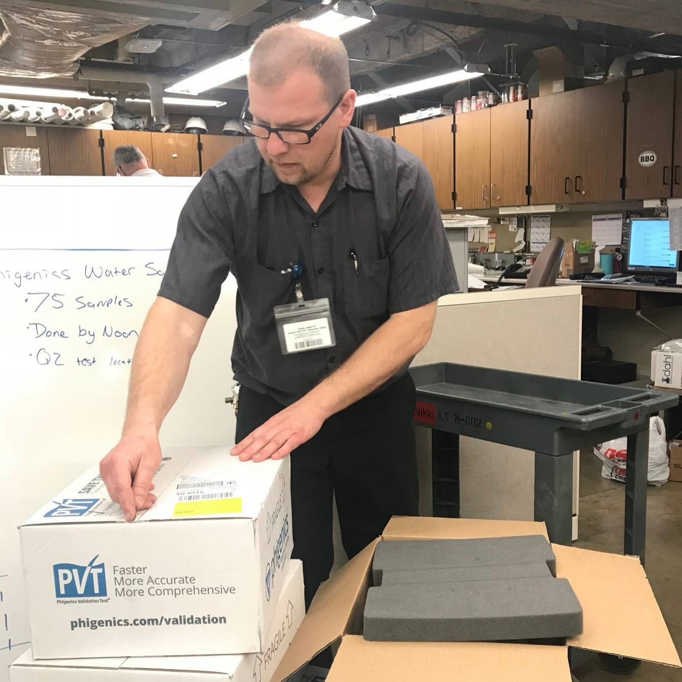 a Mayo Clinic facilities worker unpacking supplies