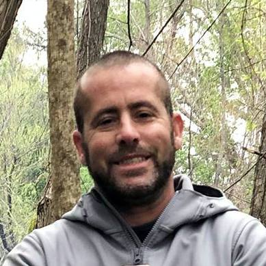 lung transplant patient Nicholas Hemmerle outdoors in the woods