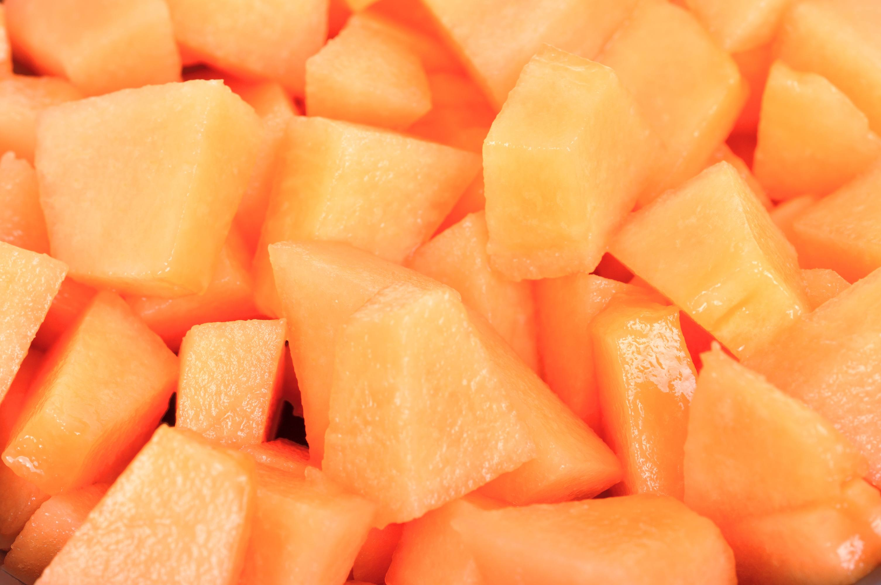 close up of chopped up and pre-cut melon, fruit