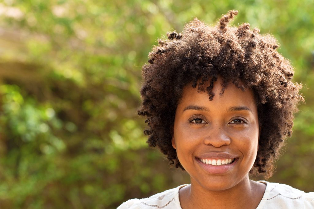 a happy young African American woman smiling