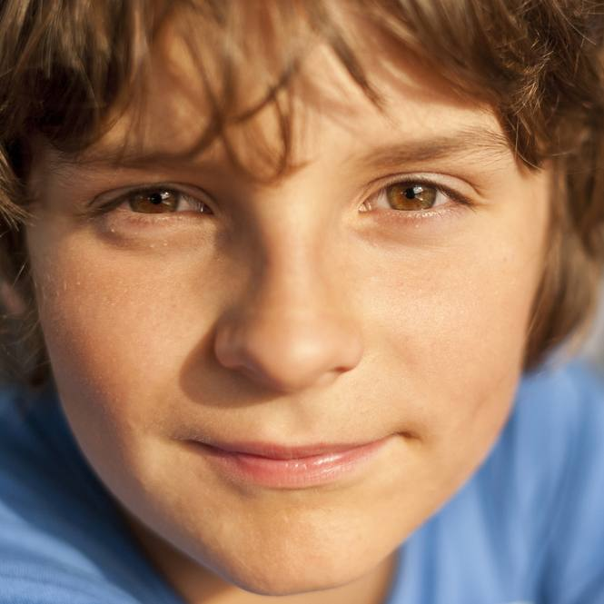 a close-up of a young teenage boy