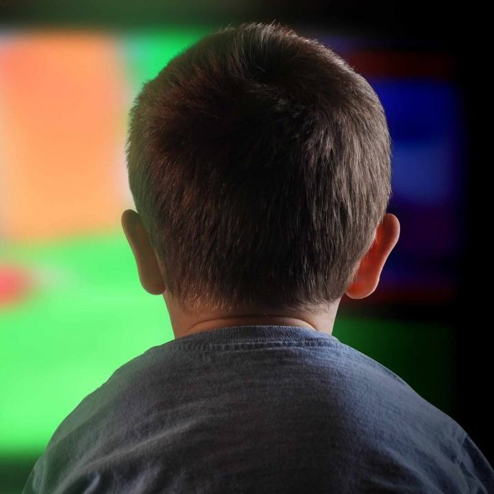 boy staring at television, screen time