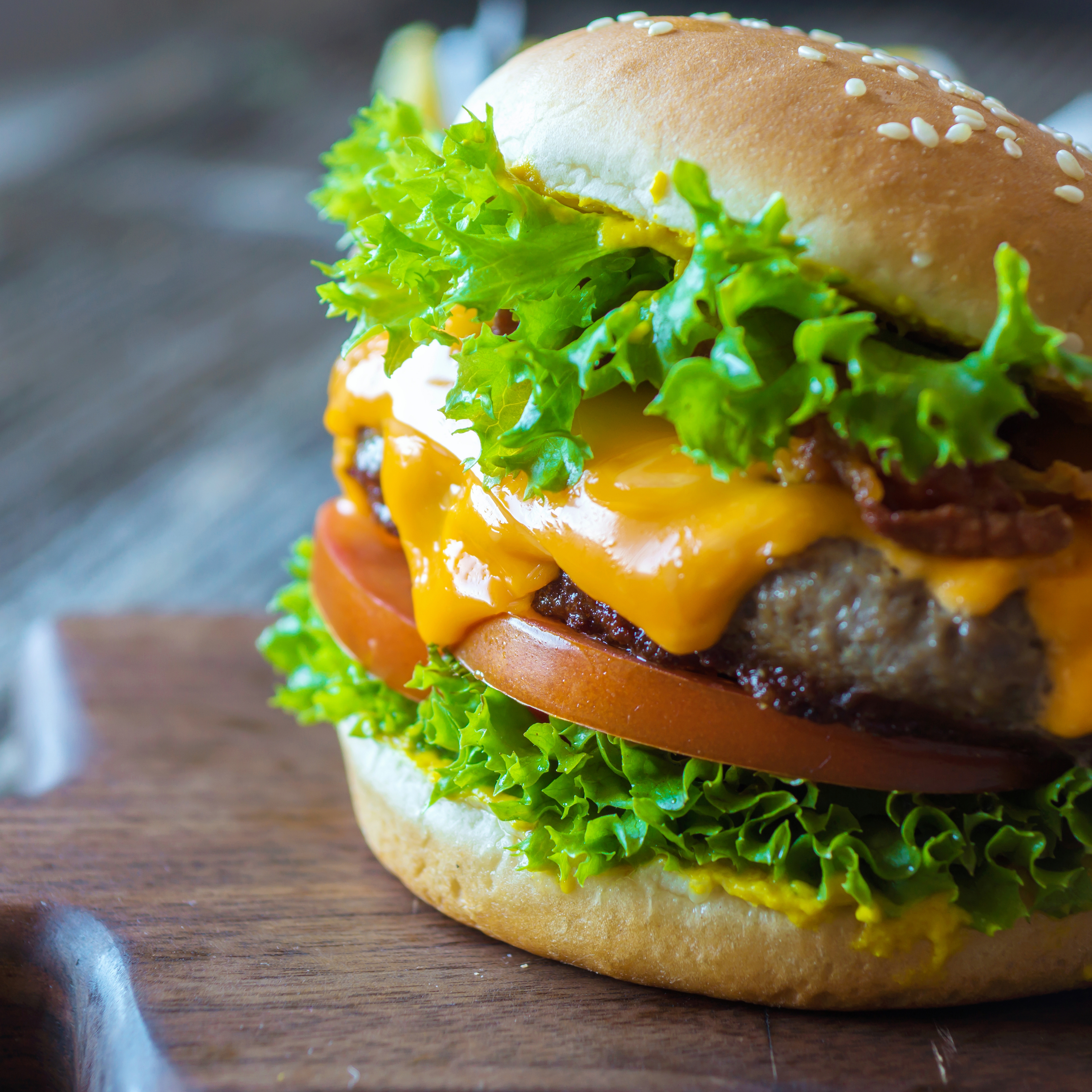 Hamburger with lettuce, tomato and melting cheese