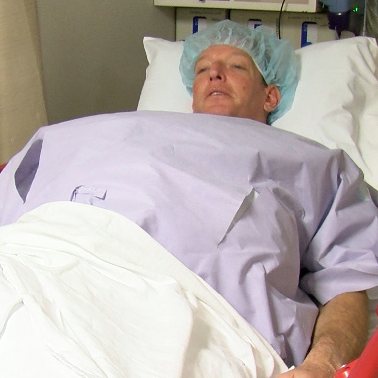 PKD patient Gene Okun in his hospital bed prepared for surgery