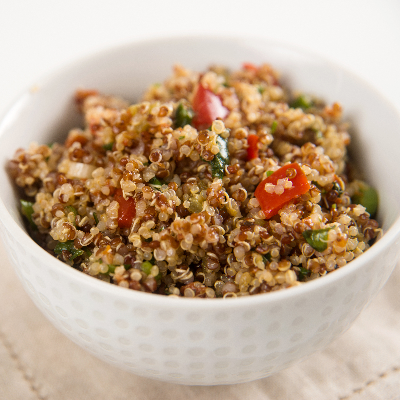 a close-up of a bowl of whole-grain quinoa tabouli salad