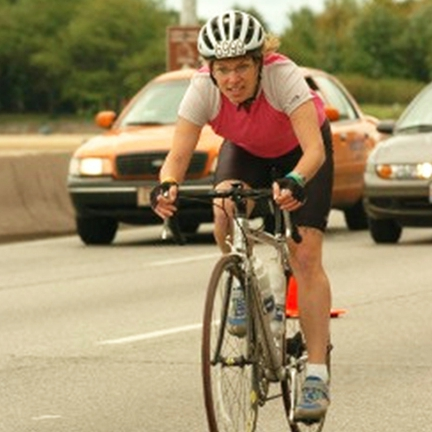 chronic hip pain patient Brenda Brault riding her bicycle