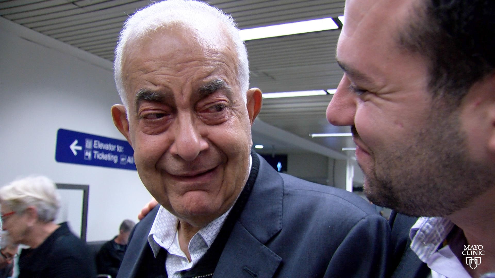 Dr. Fouad Chebib greeting his father at the airport