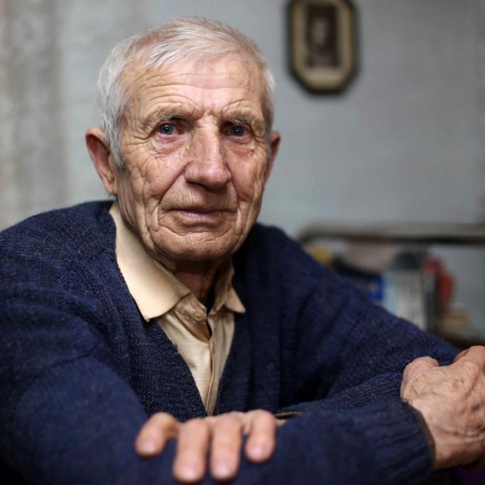 older man sitting at table
