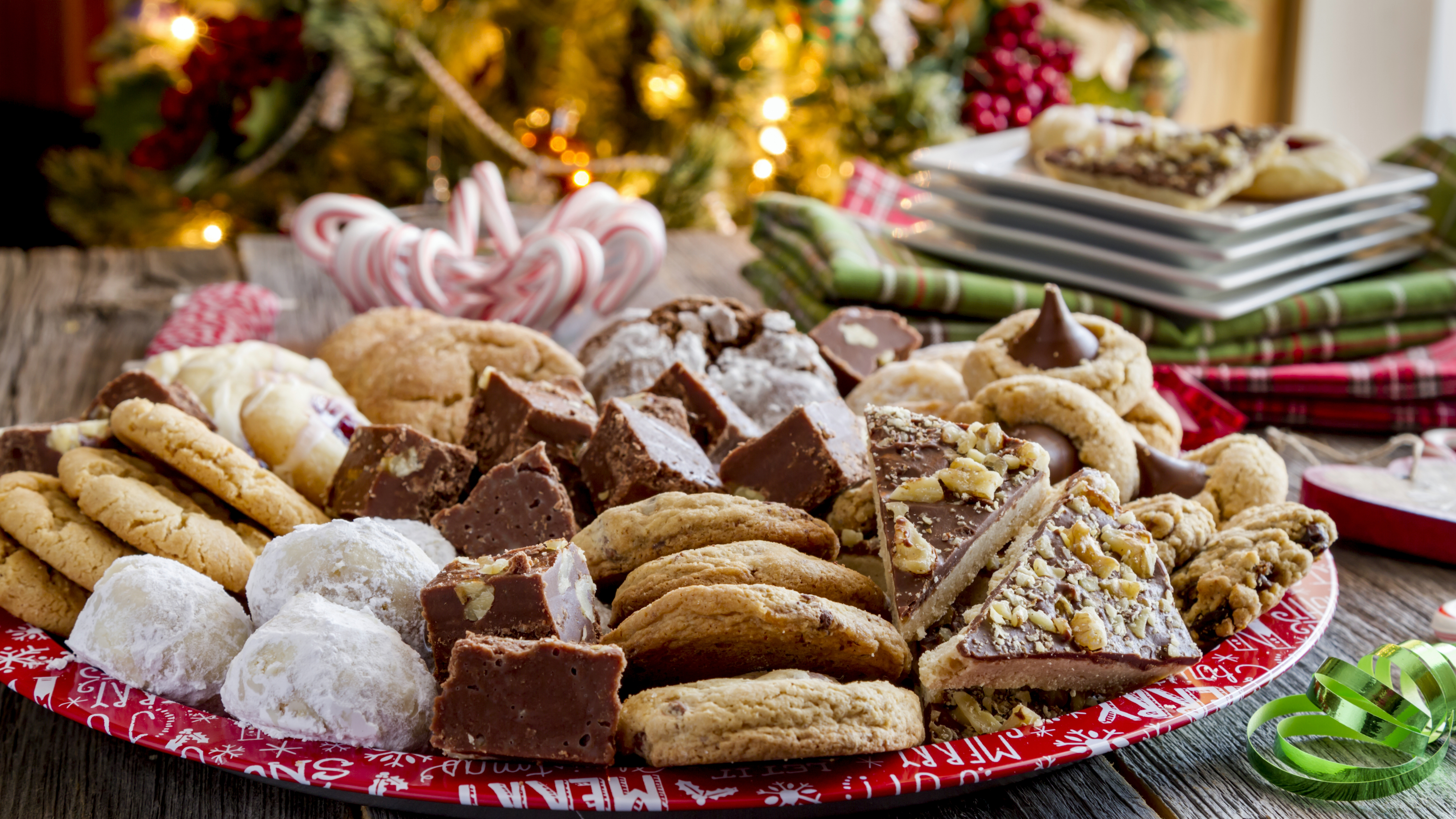 a large plate of sugar cookies and holiday treats for dessert