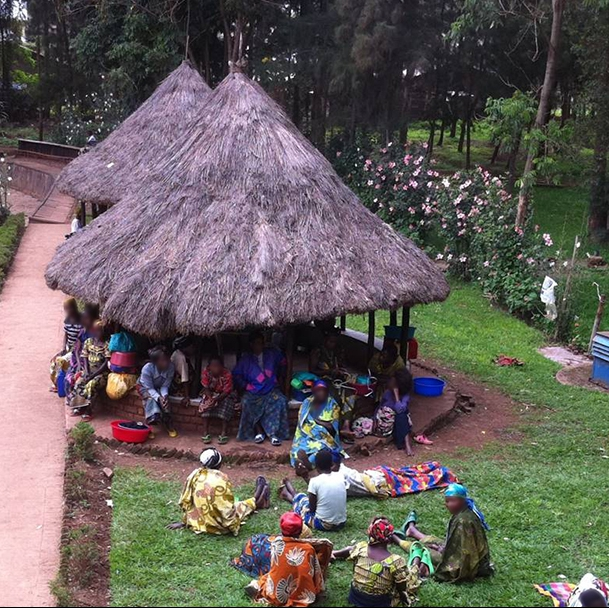 The huts where women live behind the hospital waiting for surgery in the Democratic Republic of Congo.