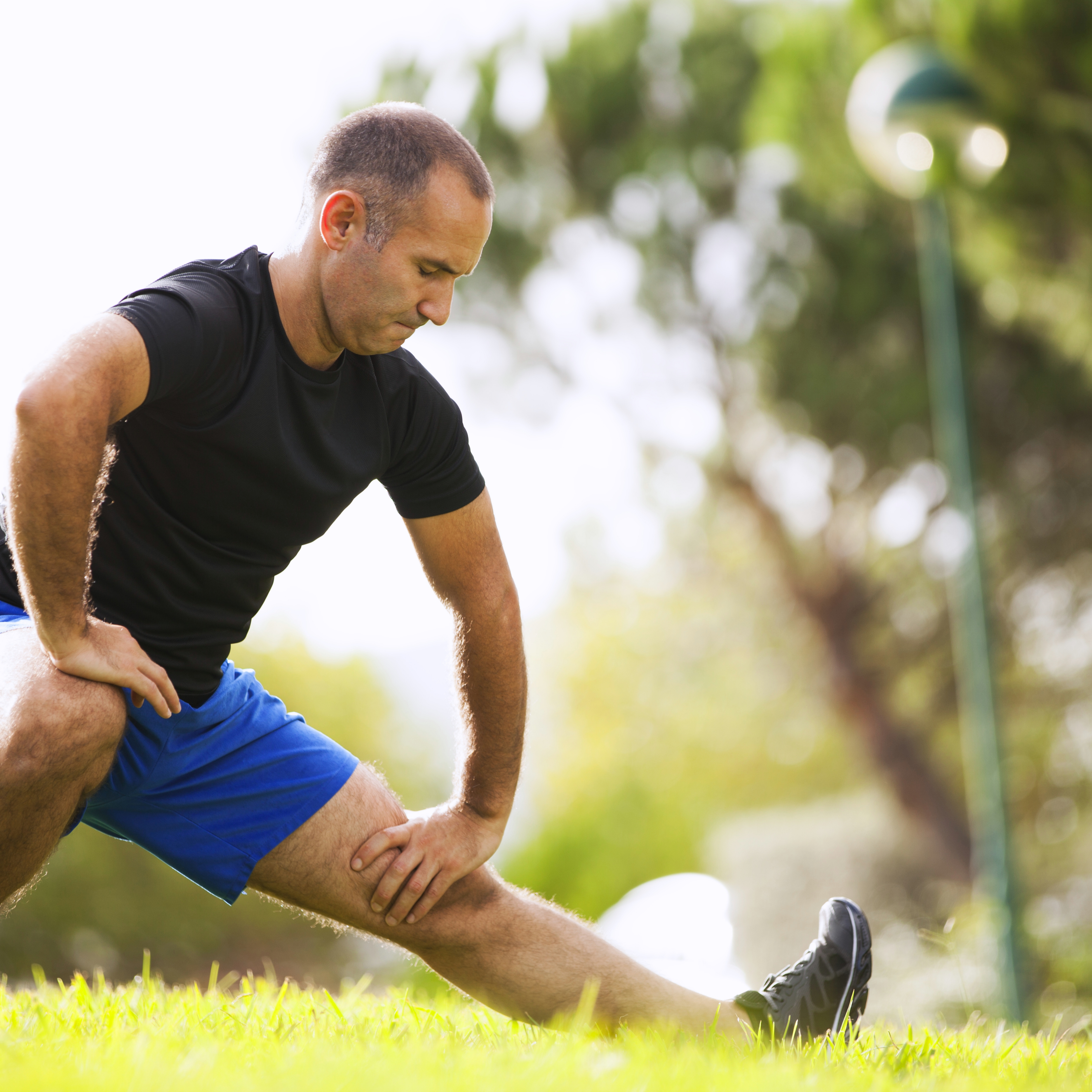 Mature man exercises in a park