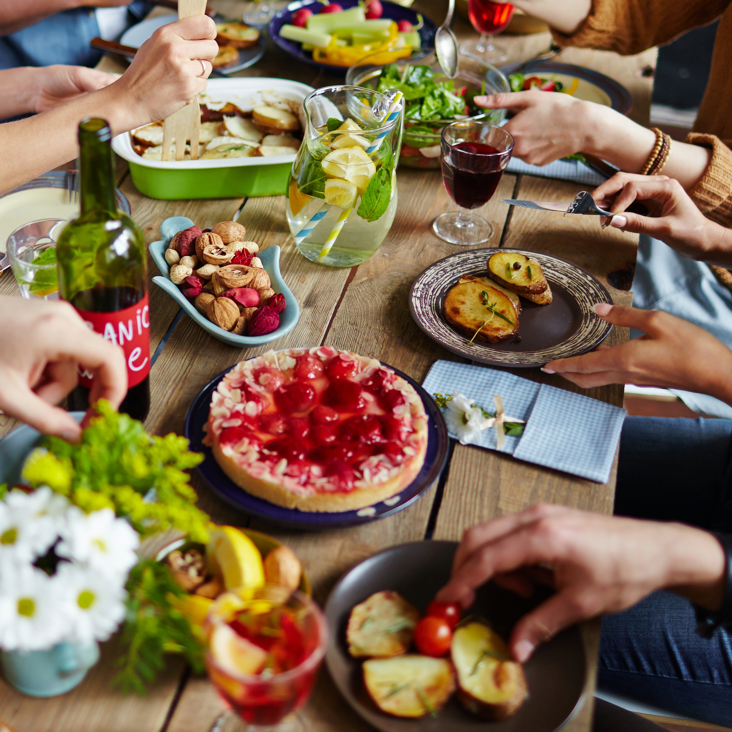 a festive holiday dinner table with a lot of people celebrating