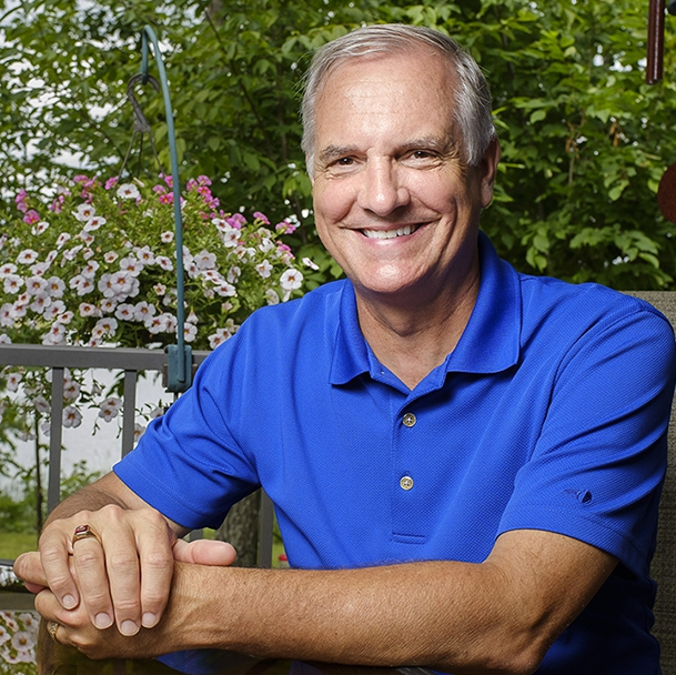 Sharing Mayo Clinic lung cancer patient Kurt Jacobson sitting on a porch, smiling
