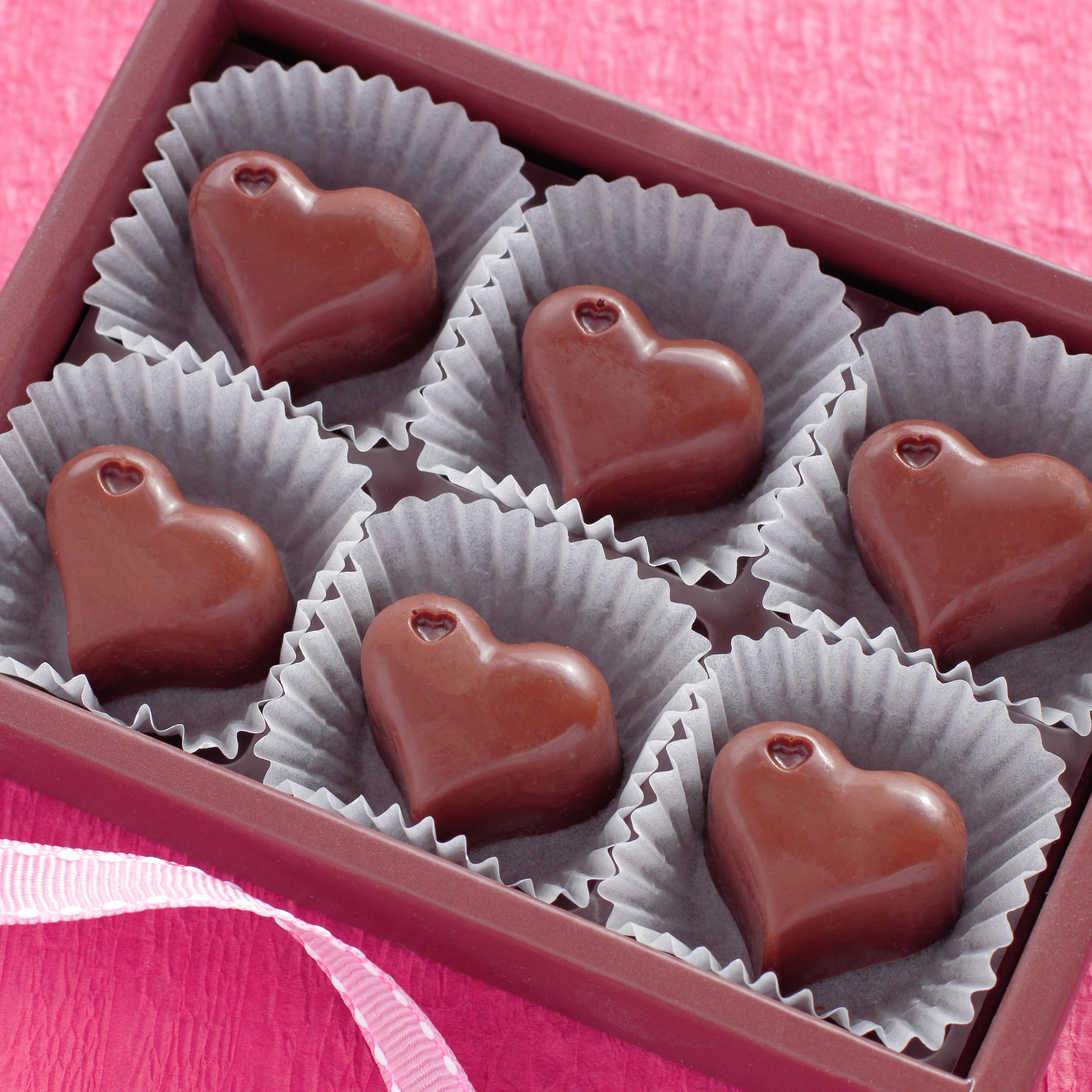 A box of heart shaped Valentine's Day chocolates.