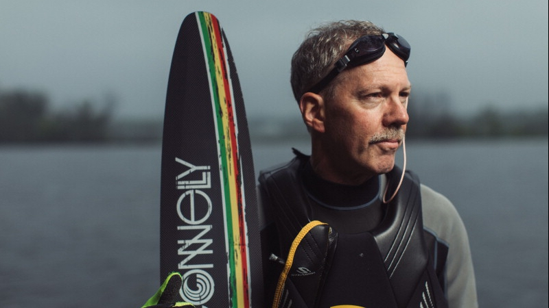 heart attack patient Brian Kanable standing by a lake with his water skis