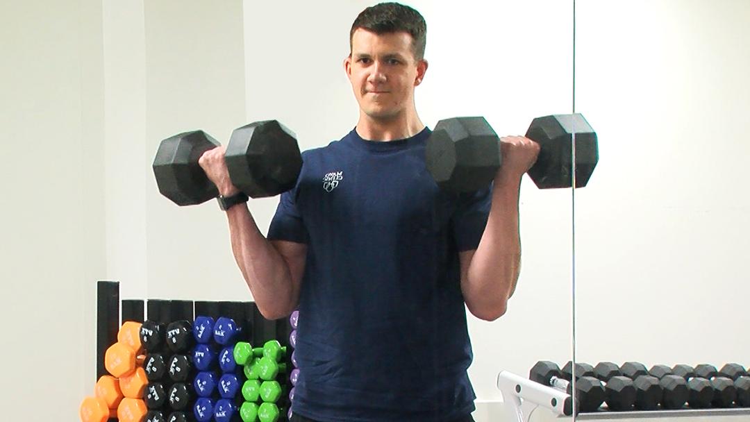 heart surgery patient Alex Zabaski lifting weights