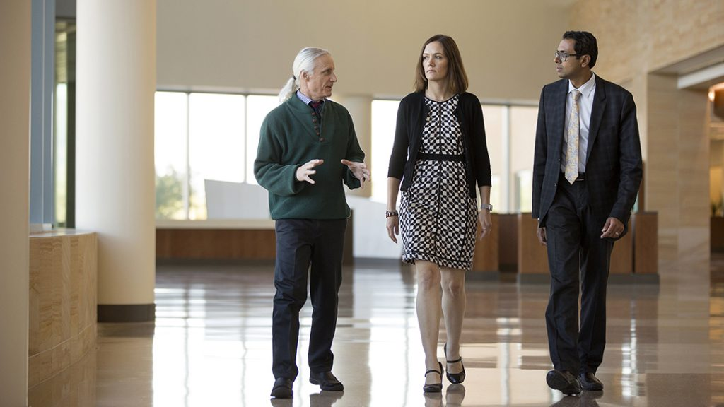 three Mayo Clinic employees having a walking meeting