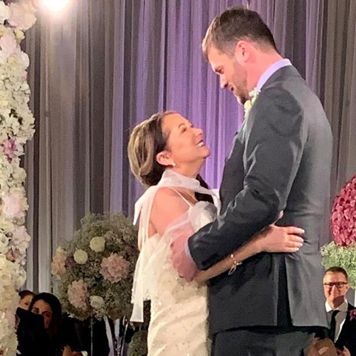 In the Loop patient Jennifer Jones and her husband, Rob Ronnenberg, dancing together at their wedding