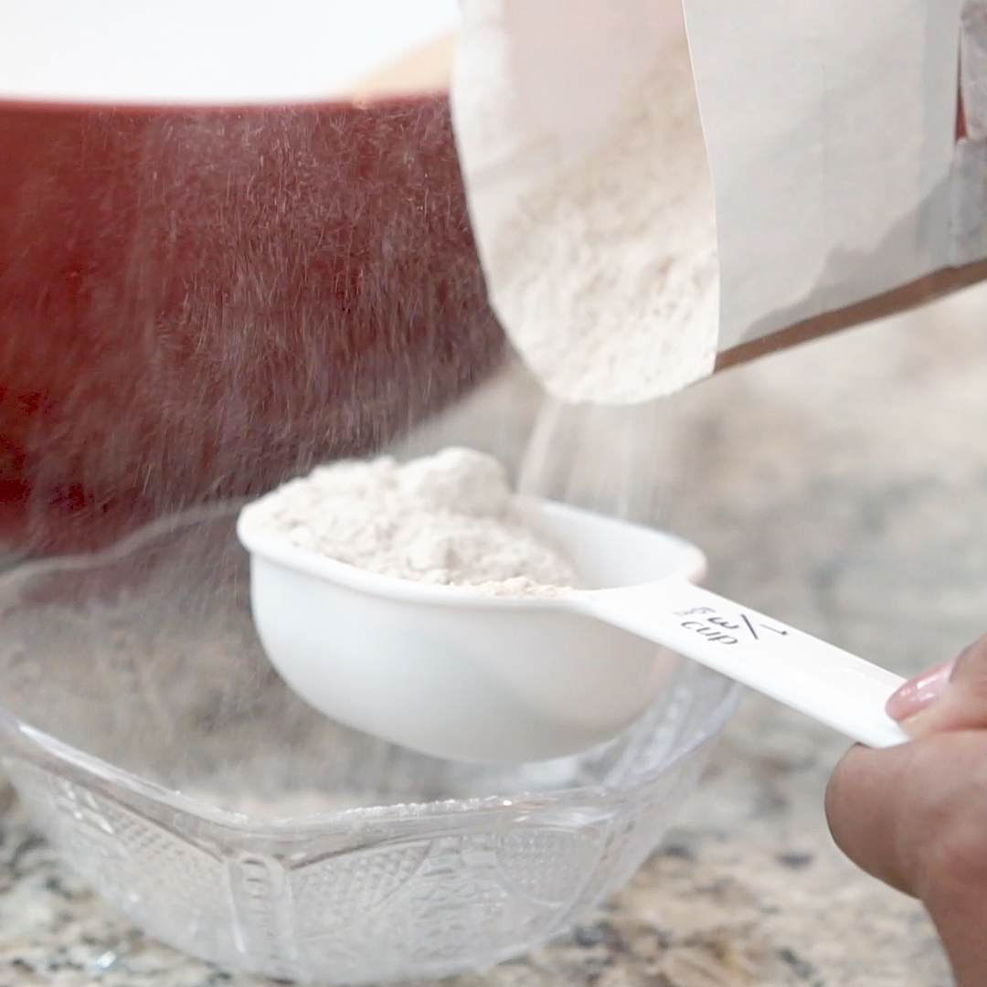 Whole wheat flour sifted into a measuring spoon