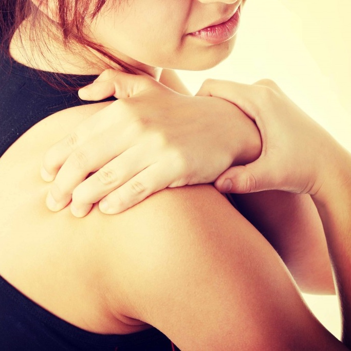 Woman holding her shoulder, pain, fibromyalgia