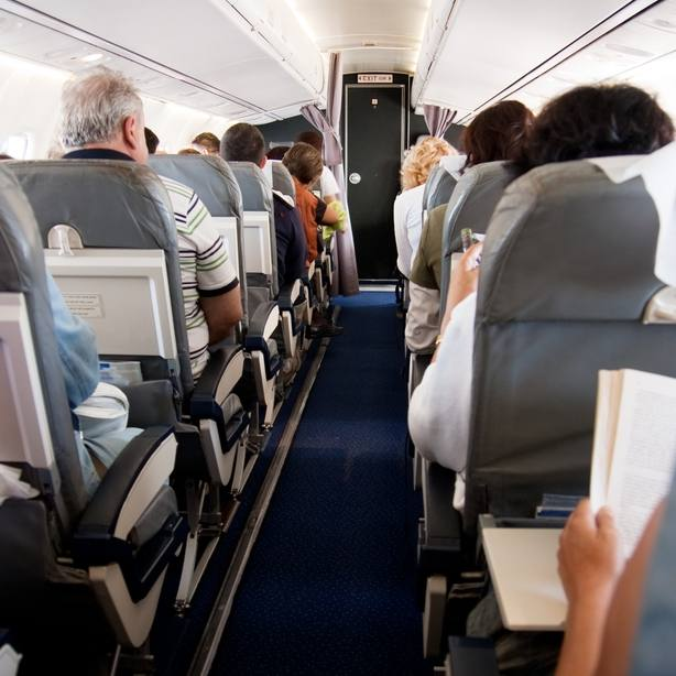 interior of an airplane with passengers sitting in their seats