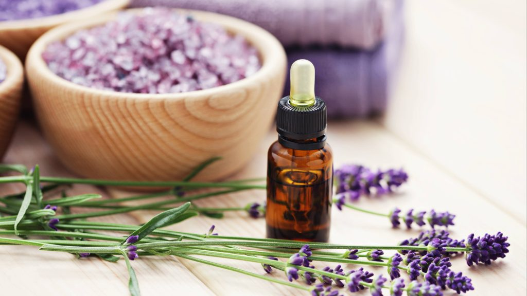 aromatherapy oil and bowl of lavender bath salt
