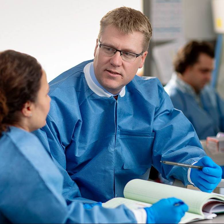 Mayo Clinic researchers Timothy J. Nelson, M.D., Ph.D., and Katherine Campbell, Ph.D. working in the laboratory