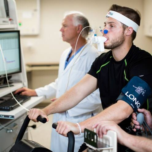 research lab staff monitoring oxygen levels in patient during a clinical trial