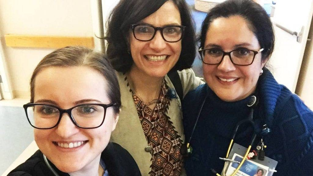 Samira Jubran (center) with Mayo Clinic's Language Services in a selfie with physicians