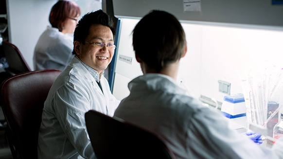 two scientists in a medical lab working on research related to aging