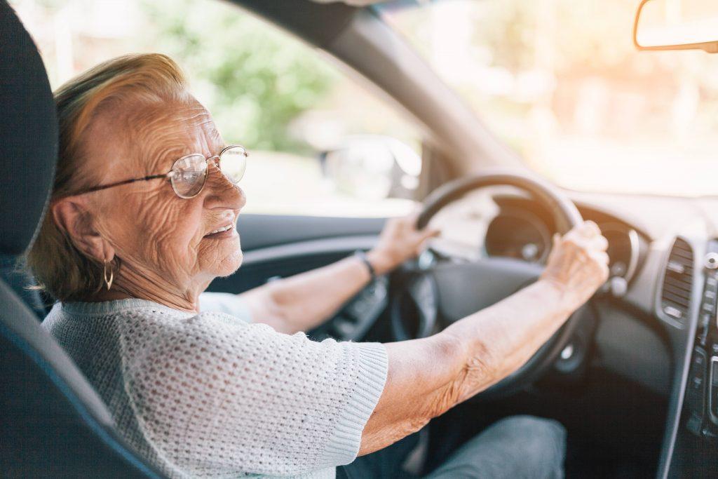 Elderly woman driving car