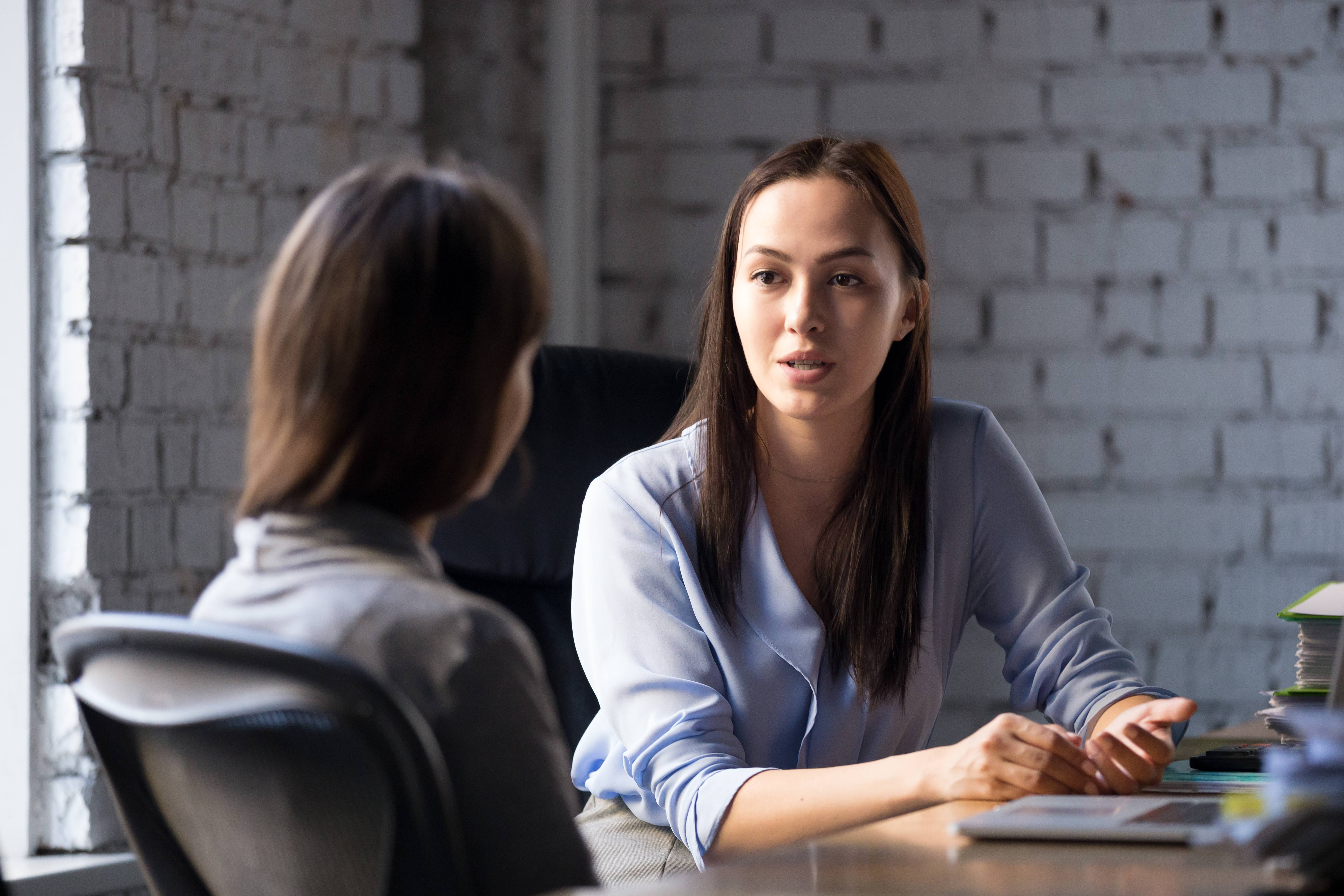professional female mentor talking with young female