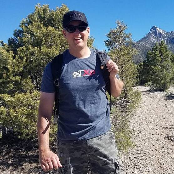 Sharing Mayo Clinic patient Patrick Metzger smiling while outside in the mountains on a biking or biking trail