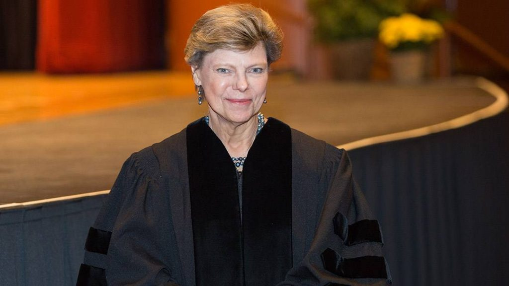 Cokie Roberts dressed in a commencement gown