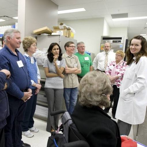 Community Advisory Board members interact with a Mayo researcher while attending a Mayo Clinic biobank open house in Rochester, Minnesota