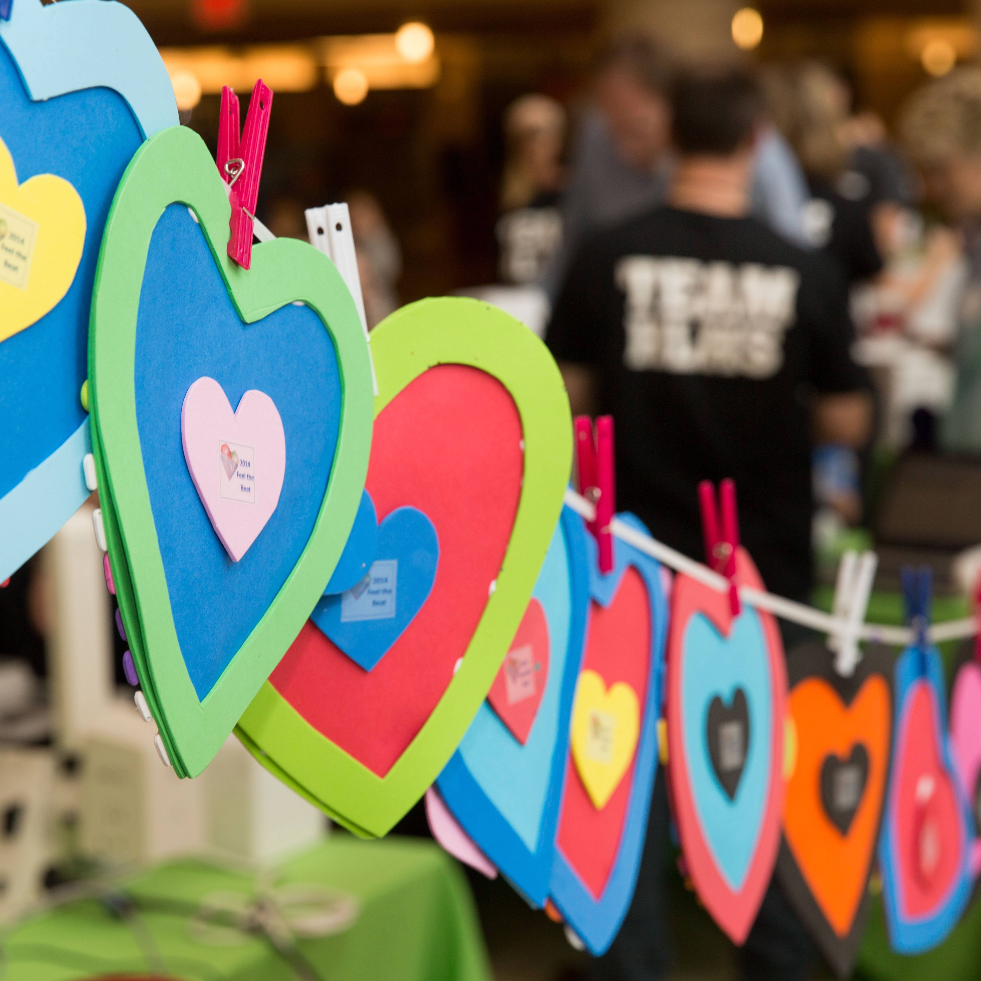 colorful cutout hearts hung up at an HLHS event