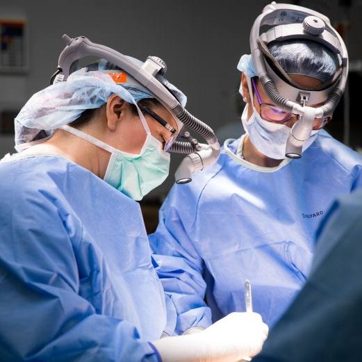 Mayo Clinic breast cancer surgeons in scrubs, operating on a patient