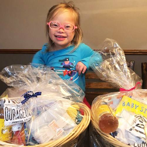 In the Loop patient Gillian Kunkel with two Jack's Baskets gift baskets