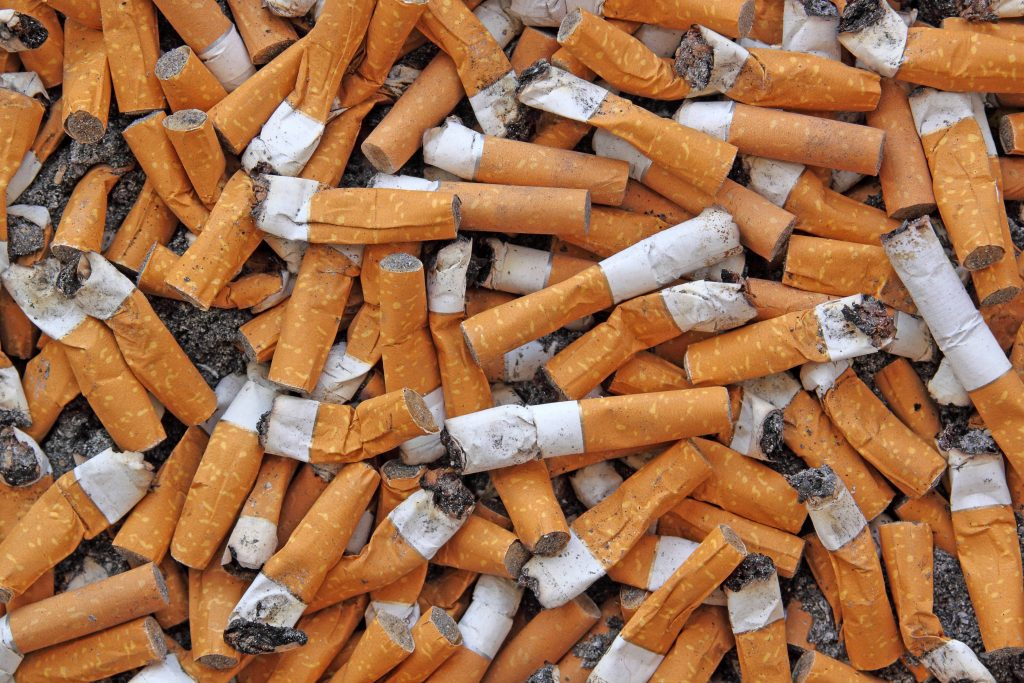 a pile of stubbed out cigarette butts