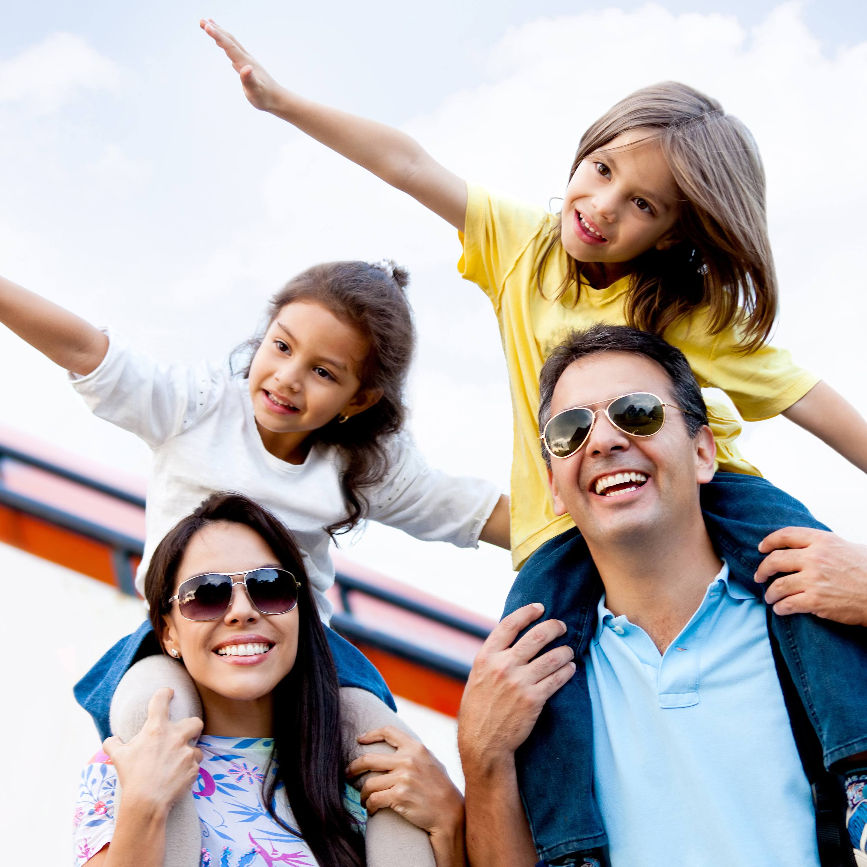 a happy young family at the airport