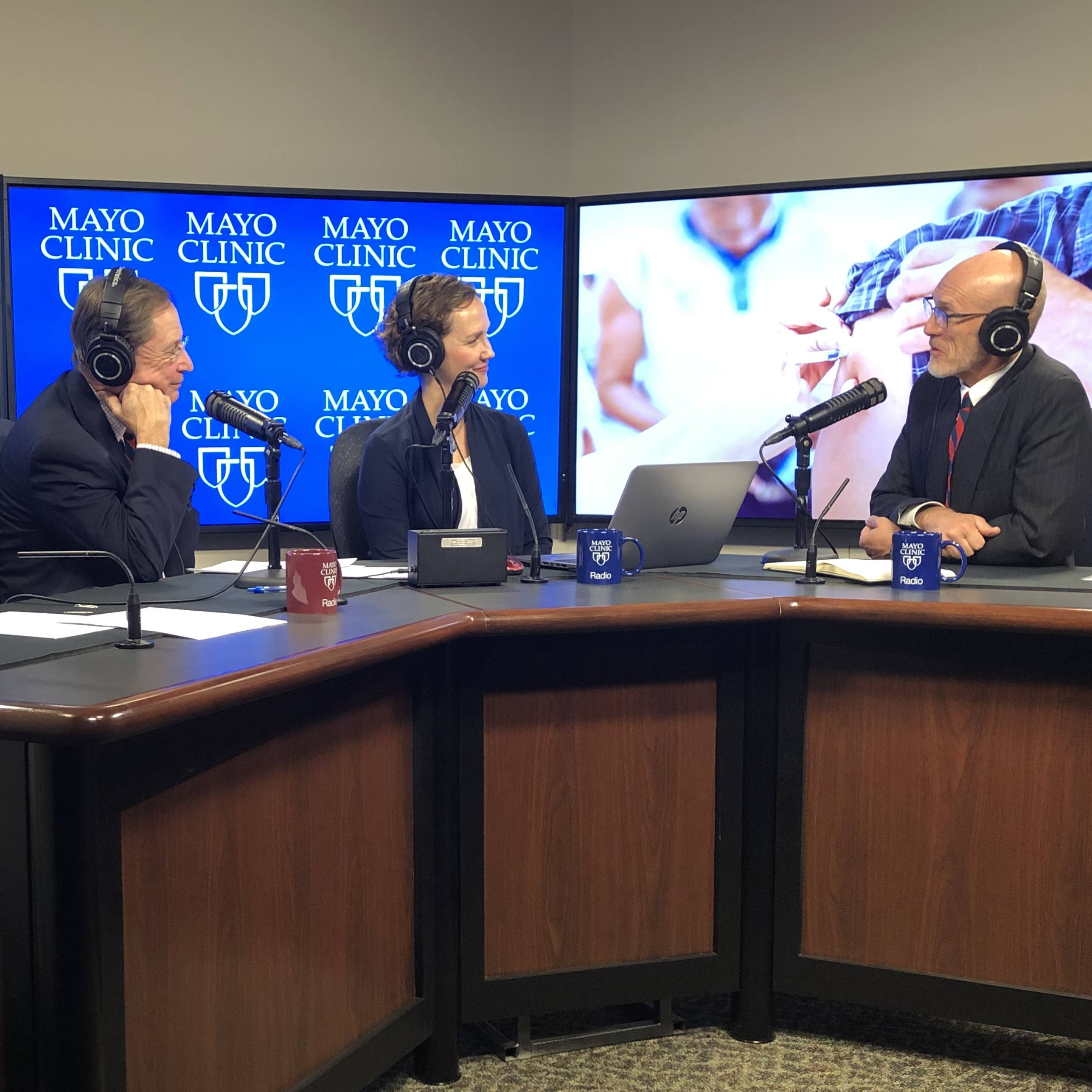 Dr. Gregory Poland in the radio studio being interviewed by Dr. Shives and Tracy McCray