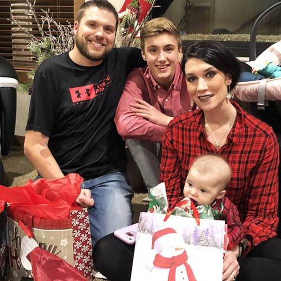 Blake Sunde and his family with holiday shopping bags