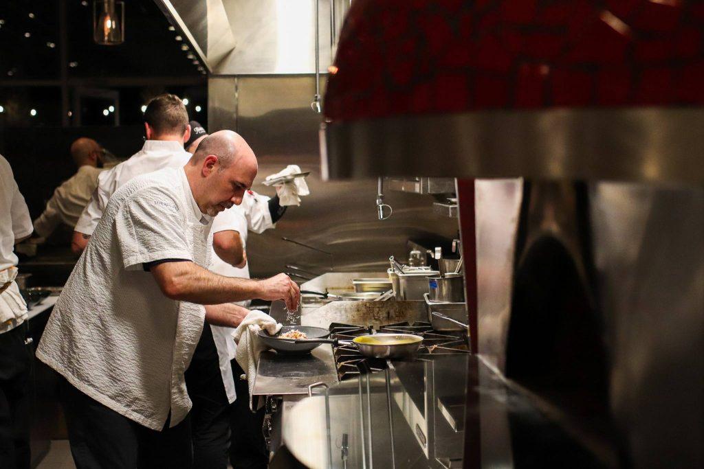 Matthew Medure works in a kitchen setting