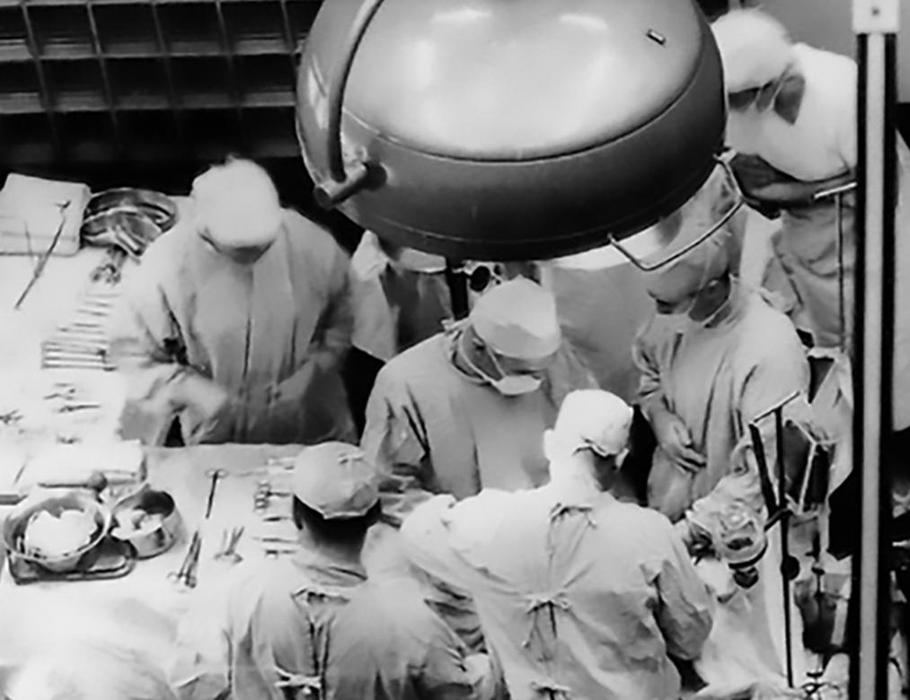 historical photo of surgeons performing a transplant surgery