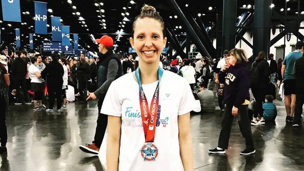 registered dietitian Mary Wirtz smiling and wearing her marathon medal